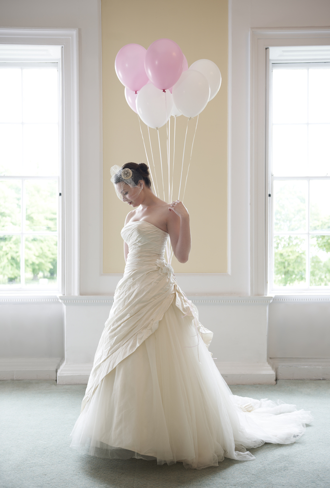 bride posing with balloons